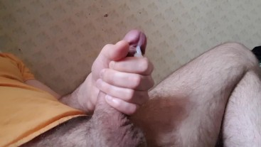 Cumming cock. Boy holds a big cock with his hand.