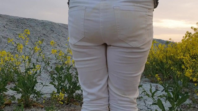 Exterior latex stains Alice wetting her pee stained white jeans in nature from our compilation