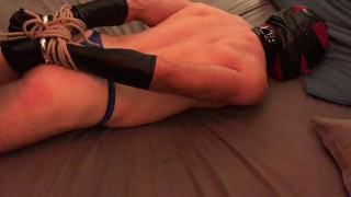 Slave gets taped, whipped and hogtied