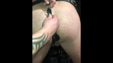 Sub restrained to chair in leather, plugged. Then got another sub to nosh