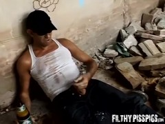 Stud is stroking his cock and pissing after slugging a beer