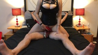 Mistress rides strap-on while slave is locked in chastity