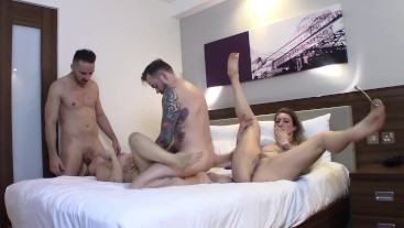 Swinger couple swapping & sharing in hotel room