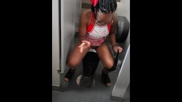 Peeing in public bathroom trash can