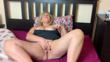 Dirty Big Tit Mature relaxes with coffee and Fingers herself to Orgasm.