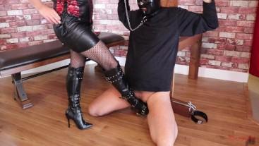 Femdom chastity slave is kicked and trampled sucks black dildo