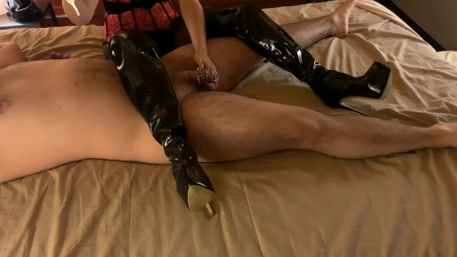 Hustler latex thigh highs Mistress in thigh high boots teases and tortures chastity slave