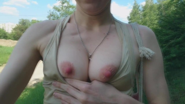 Showing your breast Summer boob flash: fit babe showing breasts in the forest