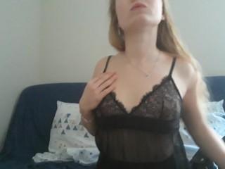 French girl masturbates in transparent nightie