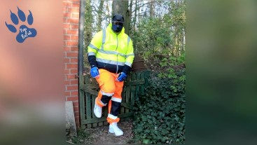 quick pawing off in hi-vis tracksuit and sneakers outdoors