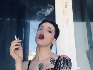 hot girl in red lipstick smoke on the balcony only in bra