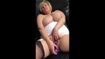 Big Tit Step Mom in girdle and stockings pounds her wet hairy pussy