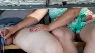 Step mom gives sonhandjob at beachside cafe under table. People around!!