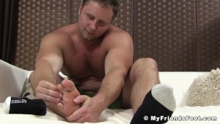Muscular gay dude teases while playing fucking his soft feet