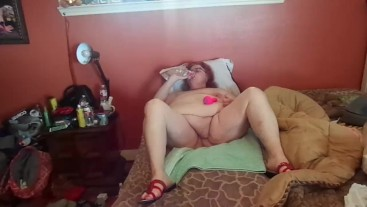 BBW Nurse Vicki in Christmas apron ,dress garters strip tease ,toy play and squirt