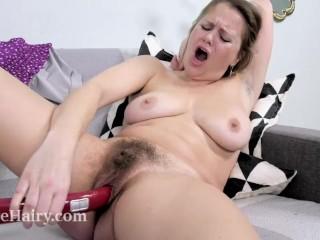 Afeena masturbates with her red vacuum handle