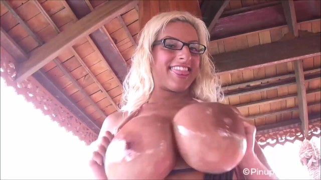 Mature archive pinup Busty taylor stevens oils up her beautiful tan tits for you
