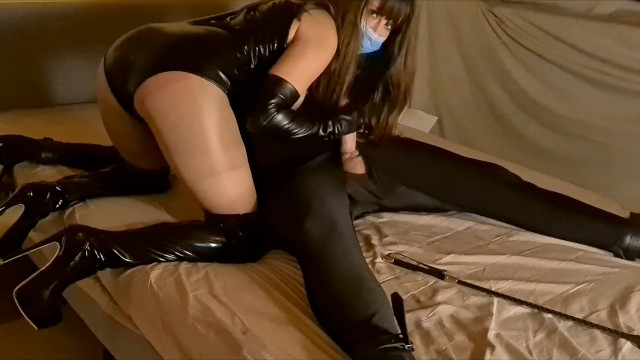 Tall goddess hardcore Leather facesitting mistress with face mask gives her tied up slave a ballbusting handjob