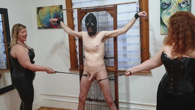 Caneing bare bottoms Dominatrix duo beats slaves cock with floggers, riding crops, and canes