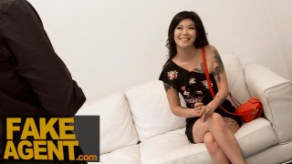 Fake Agent Tattooed asian chick swallows agents cum in casting
