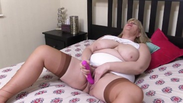 Filthy Big Tit Step Mom in Girdle and Stockings fucks her hairy pussy while husband is out.