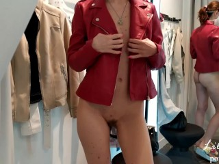 Naked girl in a fitting room.