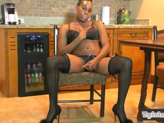 Booty Ebony trans in stockings enjoys jerking