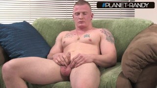 tattooed hot guy strokes his dick for you