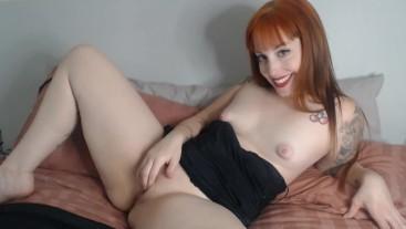 Sexy readhead teasing in cam show