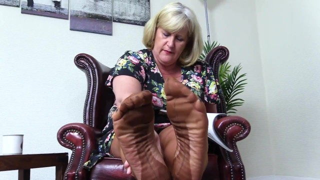 Milf in her stocings Nasty, foot fetish aunty wants you to smell her stocking feet.