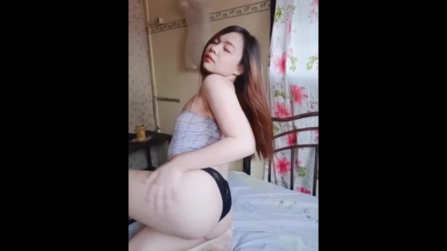 How to put a female condom in Hot asian try to put condom using her mouth on her strap-on dildo and fuck it