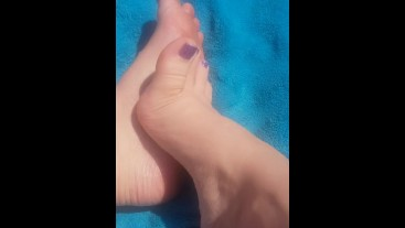 Naked sexy toes playing in the sun