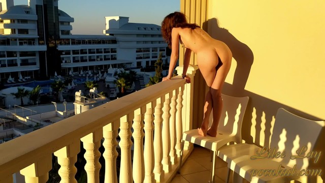 Girls naked laying down Naked girl on the balcony greets the morning