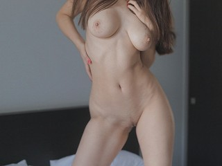 Young hottie with a beautiful body wearing only sneakers has sex on a large bed. Guy cums twice