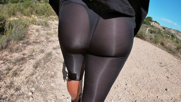 Walking erect in see thru leggings and black thong