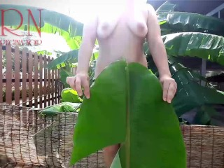 Rural striptease. Country girl dancing in the yard of her house Rustic striptease with banana leaf