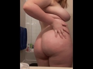 Chubby Hazel lotions up her tits after a bath