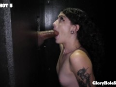 Skinny tattooed Girl sucks dicks in the gloryhole
