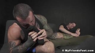 Inked hunk toe licking foot job masturbation with kinky jock