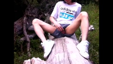 Twink goes outside in short shorts with no underwear. Will he get caught wanking and cumming?