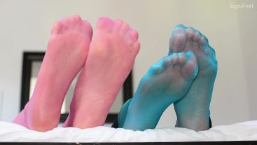 Double Nylon Feet Playing On The Bed