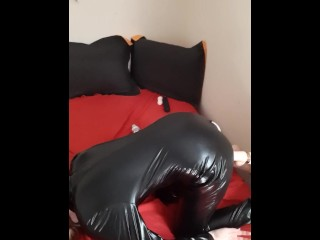 Submissive in latex takes it from behind