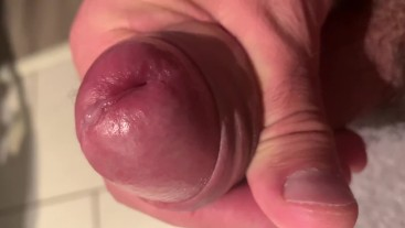 Stroking hard uncut cock and a drop of pre cum