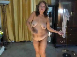 Mature Latina woman with hairy pussy dancing sensually striptease
