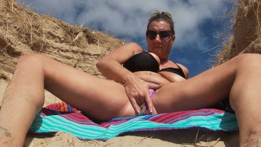 Real wife squirting on a public beach! licks up all her creamy juices!