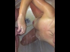 wife grips my uncut cock and gets me to piss all over her while together in the shower.