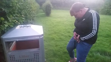 pissing into bin in the park