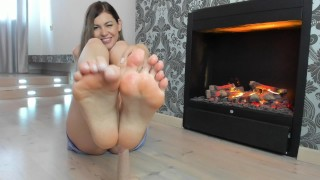 Screen Capture of Video Titled: Hot footjob near the fireplace