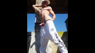 Outdoor public place 2× cumshot. Flexing arms abs, back muscles. Cumming in a row. Fit toned body.