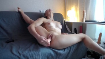 Quick masturbation by dildo with legs wide open
